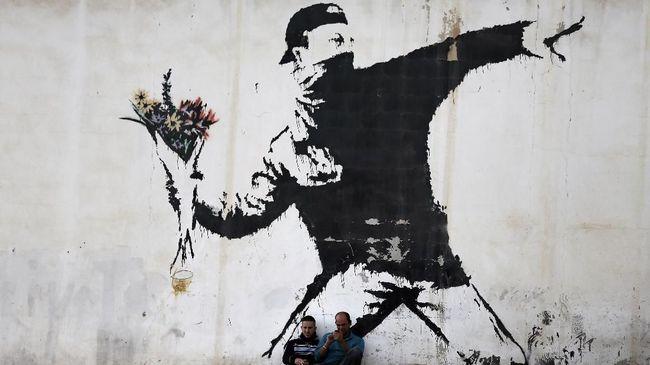 Lukisan Primata Banksy Bakal Dilelang Hingga Rp35 Miliar