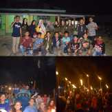 Pawai Obor Keliling Desa Sungai Sitolang, Mahasiswa KKN UR LIbatkan Warga Setempat