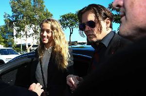 Istri Johnny Depp Mengaku Bersalah Palsukan Dokumen Anjing